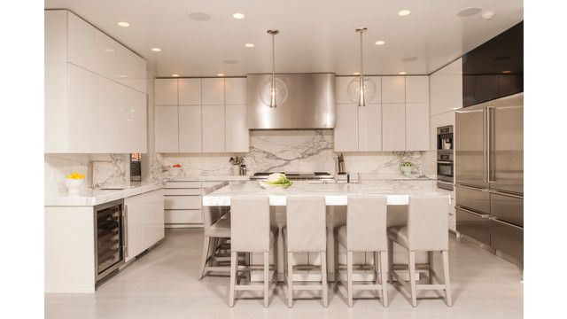 This spacious contemporary-styled New Orleans kitchen features ample seating around the island and several specialty appliances including a built-in coffee maker, speed oven and undercounter wine unit. (Kitchen by Nordic Kitchen and Baths, Metairie, La.)