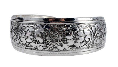 White Metal Tibetan Flower Cuff Bracelet, #10 Hinky Imports. $16.99. Made from Alloy. Width: 1 Inch. Hand Crafted By Nepalese Artisans. Chakra Balancing Protection From Negative Influences. Adjustable Size: One Size Fits All