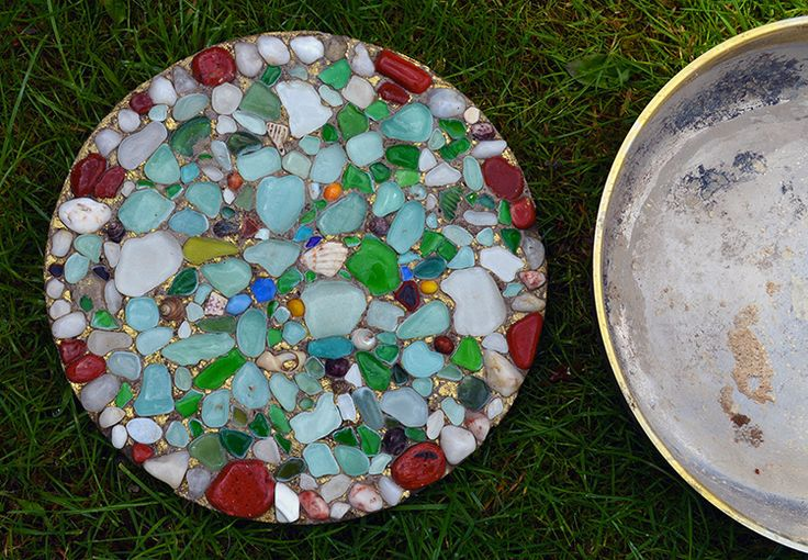 DIY - How to Make a Sea Glass Stepping Stone http://herbsandoilshub.com/diy-how-to-make-a-sea-glass-stepping-stone/  This is a wonderful DIY project that creates a garden stepping stone out of sea glass. If you don't have access to sea glass on your beaches, you can buy sea glass online.