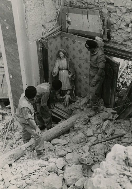 The Polish Second Corps were instrumental in the defeat of the German Tenth Army at Montecassino and the subsequent opening road to Rome for the Allies. Polish soldiers, following the road from Cassino to Rome, uncovered statues of the Madonna and Child in a chapel of a church in Piedimonte. Although the church was in ruins, the Madonna and Child emerged relatively unscathed. May 1944.