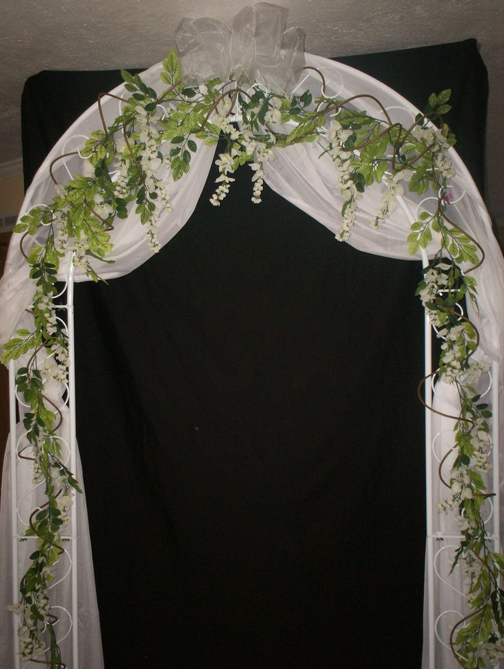 wedding flower arrangements for arches | Wedding arch with hanging curly wisteria vines and white organza ...