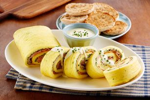 The flavors of everyone's favorite brunch staple, Eggs Benedict, without all the fuss. This omelet roll drizzled with traditional hollandaise sauce is a perfect quick fix. How did we not think of this before? #recipe #egg