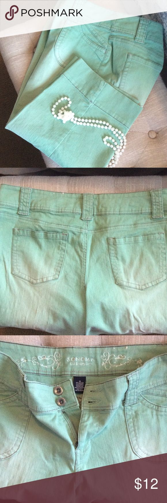 "Sonoma Seafoam Soft Jean Capris 98% cotton and 2% spandex. Very good condition.  They have that worn faded look to them both in the front and back of the Capri.   Kind of soft and Very comfy.  Has pockets in the front and the back.  Approximately 28"" from the top to the bottom of the capris with an inseam of 18"".  When laid flat the waist is 18"" across.  They are not really a light weight Capri.  Color I can best describe as a dark mint or seafoam green.  Have a slit at the end of the legs…"