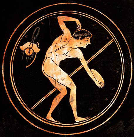 """BBC - Primary History - Ancient Greeks - The Olympic Games. Shown: """"An athlete prepares to throw a discus. You can also see the oil and strigil (body scraper) he'd use to clean off sweat and dust."""""""