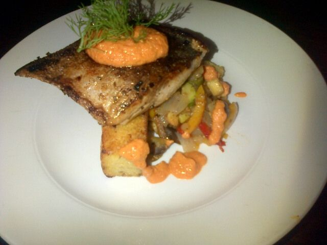 PAN FRIED YELLOW TAIL, FETA AND OLIVE POLENTA CAKE, RATATOILLE AND ROMESCO SAUCE   #DONPEDRO #WOODSTOCK #CAPETOWN
