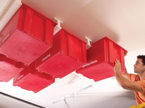 If you hate having cupboards chock-a-block with things you only use once a year, go DIY crazy and create this amazing ceiling storage solution for your garage.