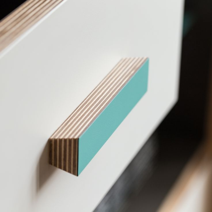 Bespoke handle in Birch ply, with coloured laminate face. Part of alcove wall unit, made by West Bridgford Joinery, designed by Caroline Bolt.