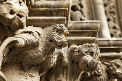 Dragon gargoyles carved in stone line the main entrance door to St. Giles Cathedral in Edinburgh, Scotland