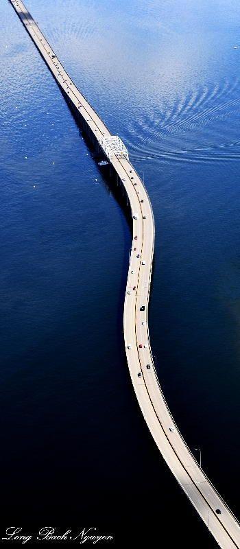 State Route 520 Evergreen Floating Bridge spans between University of Washington to Bellevue across Lake Washington.