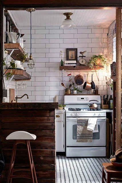 This industrial kitchen, which is accented nicely with both vintage and rustic elements: