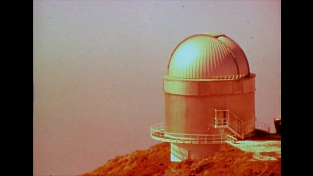 "Official video for Destination Unknown - track by Killawatt, Super 8 film by Cherry Kino  ""Entirely shot on Super 8 and processed by hand in my lab, the film includes extremely diverse footage, a lot of which was shot in the Canary Islands and also in Yorkshire. The opening shots are of the extra-terrestrial looking Observatory of El Roque de Los Muchachos in La Palma (home to one of the most extensive fleets of telescopes in the world), set high high up in the red rock mountains. The…"