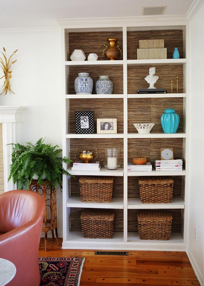 bookshelves lined with grasscloth for office