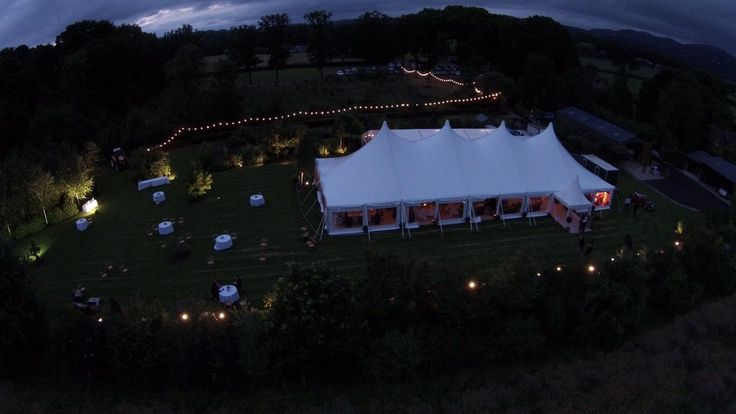 """""""Summer time means sheer top tents! The Aurora by Anchor makes any wedding glow. #Aurora #anchortents #weddings"""""""