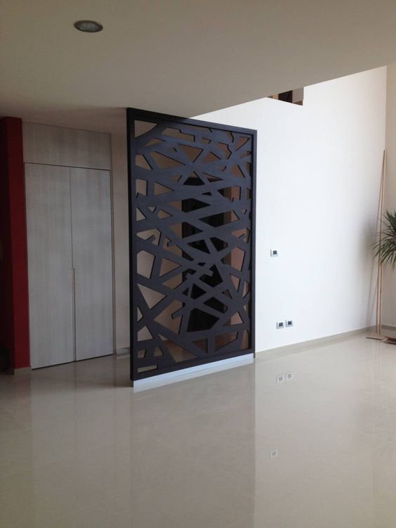 A gorgeous cut out room divider is an excellent addition to those homes whose entry opens directly into their home. ~Coral