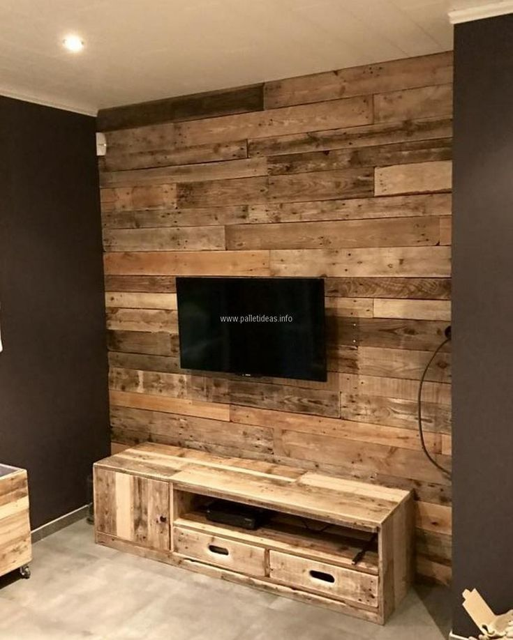 See the look of wall art with TV stand, this idea not only fulfills the need of attaching the TV, but also allows space for placing the item for adorning purpose and it also contains the specific spaces to place the TV linked items.