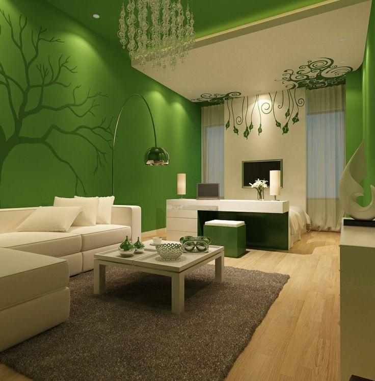 Farben für Wohnzimmer - Dunkelgrün mit Wandtattoo bei einer weißen Einrichtung