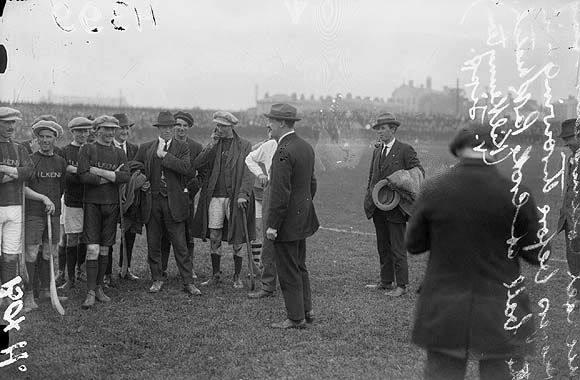 This is Michael Collins talking to Kilkenny hurlers before the 1921 Senior Hurling Championship match against Dublin at Croke Park. Dublin beat Kilkenny 4-4 to 1-5 in front of 17,000 spectators.