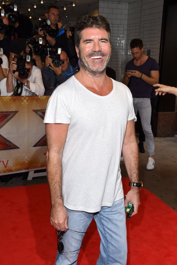 Simon Cowell ditches smart for scruffy with BEARD and baggy outfit ...