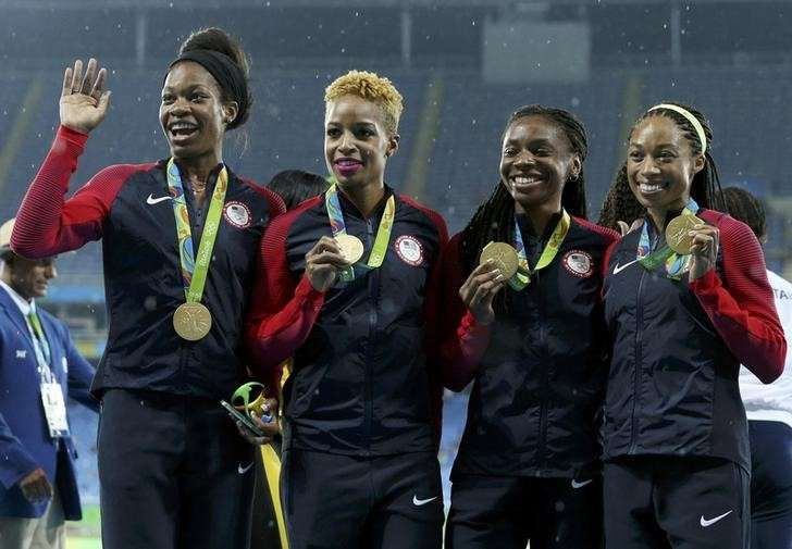 2016 Rio Olympics - Athletics - Victory Ceremony - Women's 4 x 400m Relay FINAL.. 1) 3.19.06.- GOLD for Team USA's Phyllis FRANCES, Natasha HASTINGS, Courtney OKOLO, Allyson FELIX; 2) 3.20.34 - Silver for #JAM; & 3) 3.25.88 - Bronze for #GBR; 8/20/16