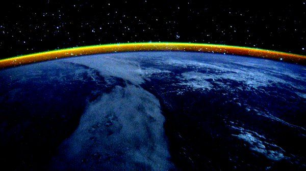 """""""Day 207, dusk over the Indian Ocean with a yellow band on the horizon,"""" this tweet read. The yellow band is the light of the Sun reflecting on the atmosphere. NASA/Scott Kelly"""