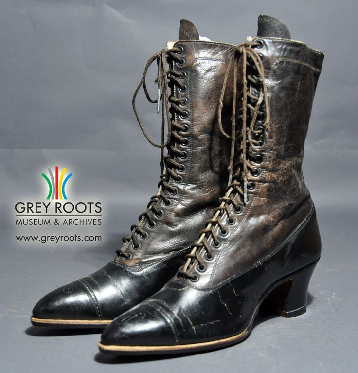 """A pair of ladies', black leather, lace-up boots. The boots' narrow toes feature a facy, pin-pricked design. Inside the left shoe there is a label which reads, """"Made Expressly for E.C. Scarrow, Owen Sound, Ont."""". Grey Roots Museum & Archives Collection."""