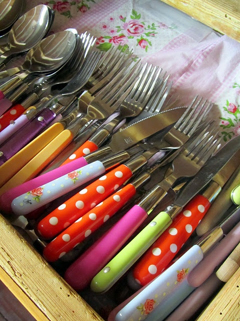 Cutlery~I love the look of the vintage cloth underneath this colorful collection of cutlery