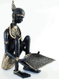 Tribal Lady - Sculpture Dhokra Art  Dhokra art is non–ferrous metal casting using the lost-wax casting technique. This sort of metal casting has been used in India for over 4,000 years and is still used.