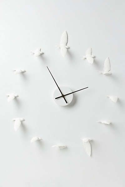 Anthropologie - Circling Swallows Clock.  I wonder if this could be a DIY project