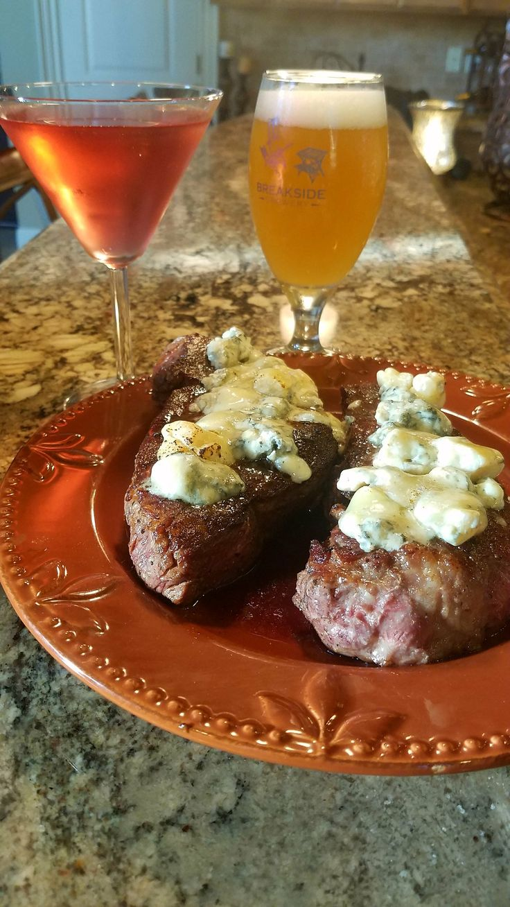 Sous vide NY Strips.  130 degrees for 1 1/2 hours and then seared at high temp for 30 to 60 seconds.  Topped with gorgonzola a d melted with kitchen torch.  Restaurant quality steaks in your own home!