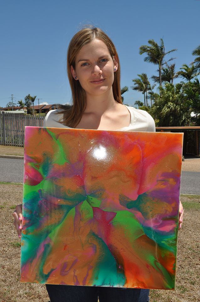 Artist Jodie Lyle with her brightly coloured resin artwork  www.picturesqueresinart.com
