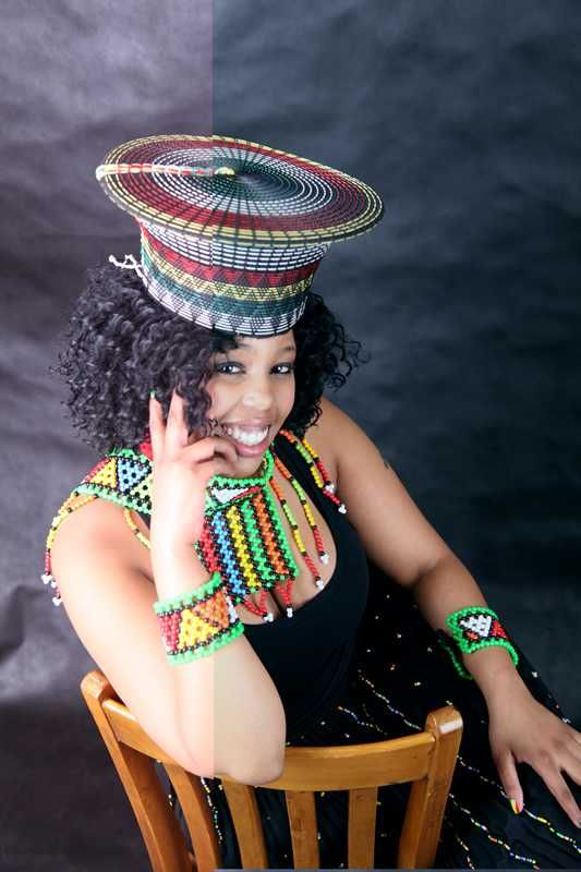 The Traditional Zulu hat has been handcrafted out of traditional cloth and set with Zulu patterns ...