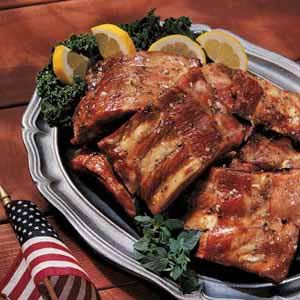 "Honey Barbecued Spareribs Recipe -""BASTING with the honey-and-oil glaze seals in the goodness of these delicious ribs as they bake to a golden brown. They can be prepared in the oven, or on the grill in a foil packet to keep the meat juicy."""