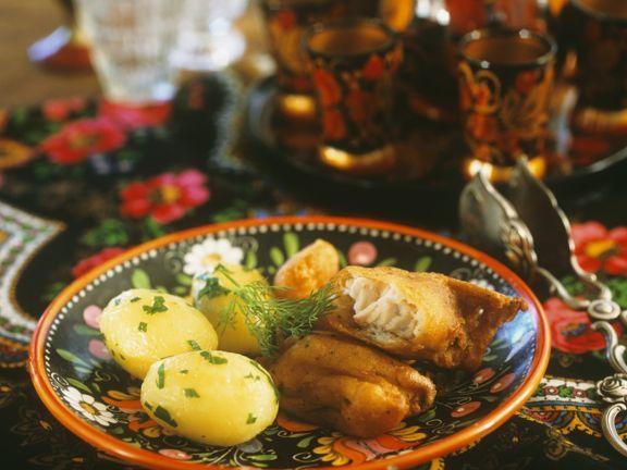 Frittierter Fisch mit Kartoffeln ist ein Rezept mit frischen Zutaten aus der Kategorie Wurzelgemüse. Probieren Sie dieses und weitere Rezepte von EAT SMARTER!