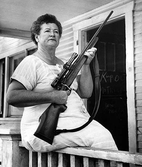 July 31, 1958 Lomie Puckett stands guard to prevent bulldozers from leveling her Edendale house for the construction of the Golden State Freeway. Puckett wanted more money than offered for the house.  Read more about the incident on Framework.  (via latimes)