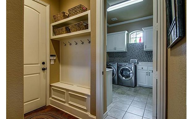 Perfection- storage next to the entrance which is next to this huge laundry room!
