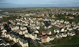 Britain's first garden town: housing crisis solution or 'dog's breakfast'? How the development of old market town Bicester turned ugly: Bicester looks an ideal location for new homes ... aerial view of the town