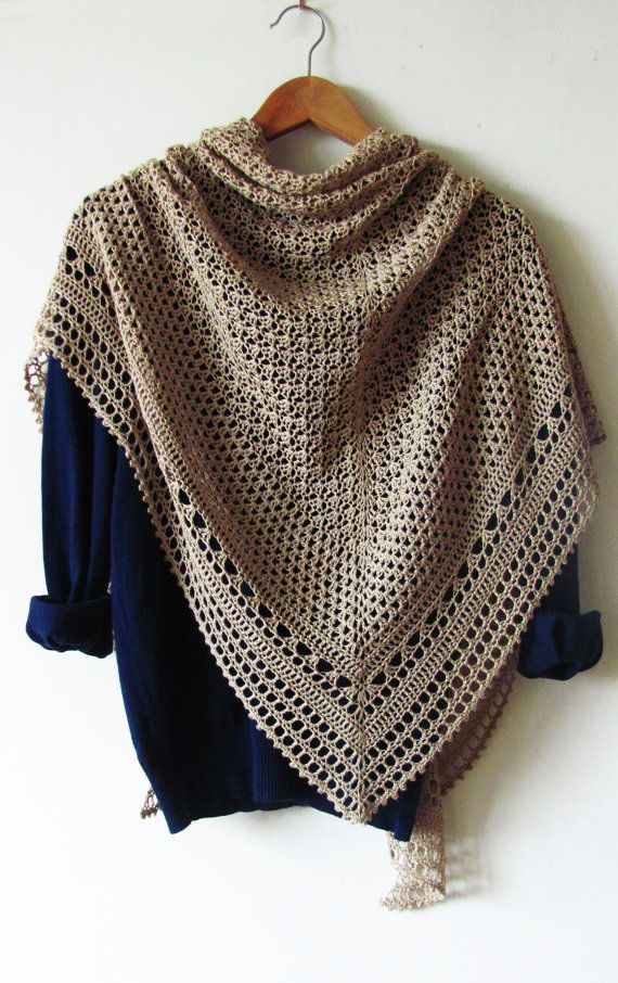 This huge crochet shawl can easily be fastened with a shawl pin for a poncho-like appearance