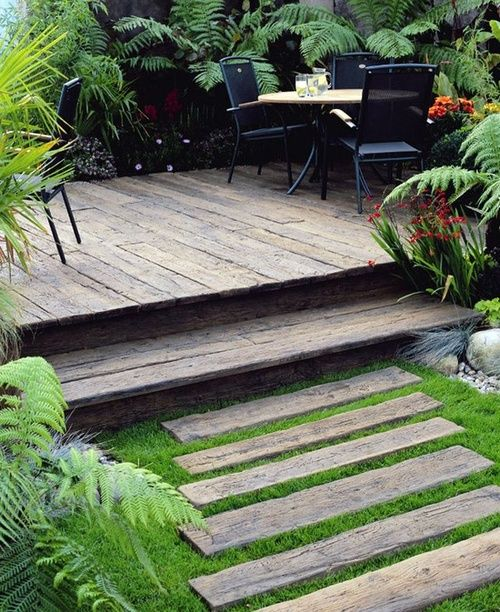 chunky floating deck, possibly  stained scaffold boards.