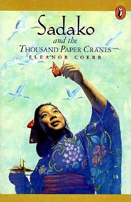 "Sadako and the Thousand Paper Cranes (chapter book):  Hiroshima-born Sadako is lively and athletic--the star of her school's running team. And then the dizzy spells start. Soon gravely ill with leukemia, the ""atom bomb disease,"" Sadako faces her future with spirit and bravery. Recalling a Japanese legend, Sadako sets to work folding paper cranes. For the legend holds that if a sick person folds one thousand cranes, the gods will grant her wish and make her healthy again."