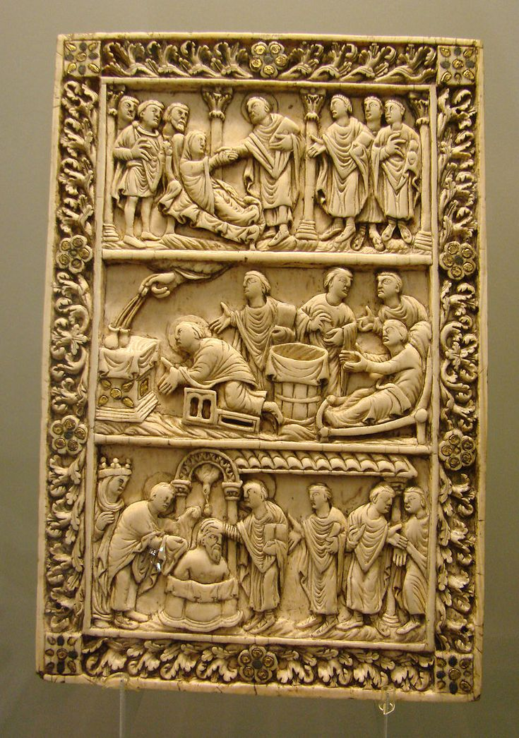 Ivory plaque, probably from a book cover, Reims late 9th century, with two scenes from the life of Saint Remy and the Baptism of Clovis. Carolingian Art.
