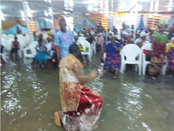 Unbelievable! Delta Pastor and His Church Members Seen Worshipping Inside Flooded Church (Photos)