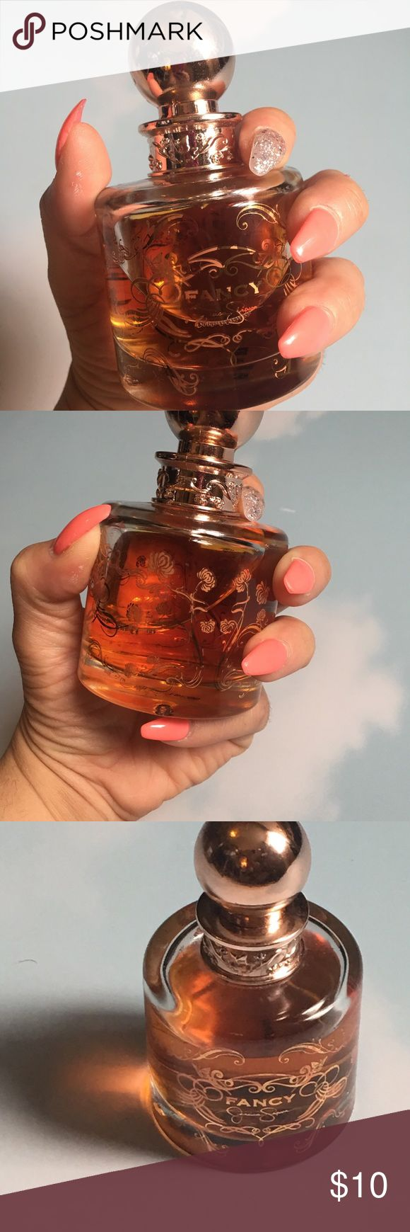 "Jessica Simpson Jessica Simpson perfume ""Fancy"".  Used 4x's, no box, bottle is full. Smells warm and sweet very similar to the original Burberry perfume. Jessica Simpson Other"
