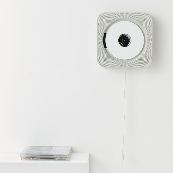 Wall mounted CD player with radio and remote control