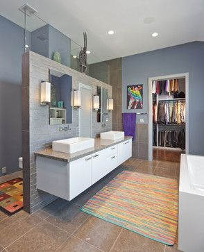 Shower behind screen (not all the way to ceiling) with vanity on other side and then bath along wall opposite vanity.  Doorways x 2 opposite each other.