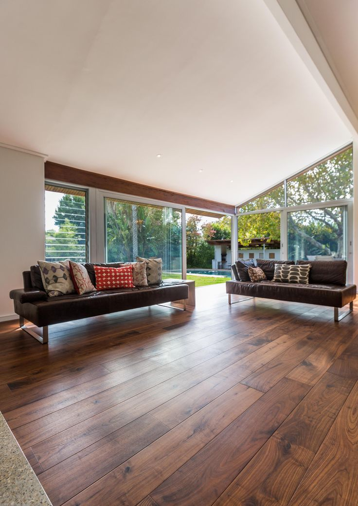 Different angle of a contemporary living space we fitted with Walnut flooring