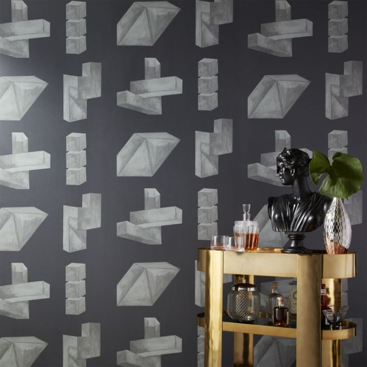 Shop Judd Basalt Wallpaper.   Geometric watercolor shapes form graphic patterned wallpaper in dark grey.  Drawn in watercolor to help soften the object's hard lines, each three-dimensional formation organically combines as one.