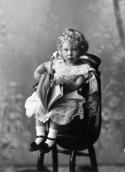 Prince Edward Albert (1894 - 1972), later King Edward VIII and the Duke of Windsor, seated in a high chair with a book, 1896. Description from gettyimages.co.uk. I searched for this on bing.com/images