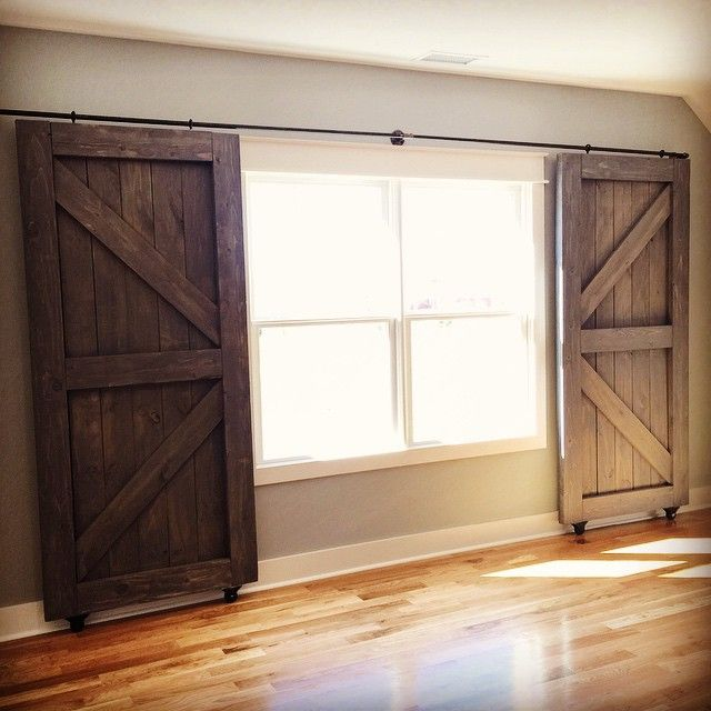 25 best ideas about country window treatments on for Barn doors over sliding glass doors