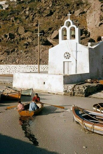 The port of Fira in 1958. What you on floating on the sea is not dirt. It is small pumice stand.  Fira port, Santorini island, Greece. - selected by www.oiamansion.com