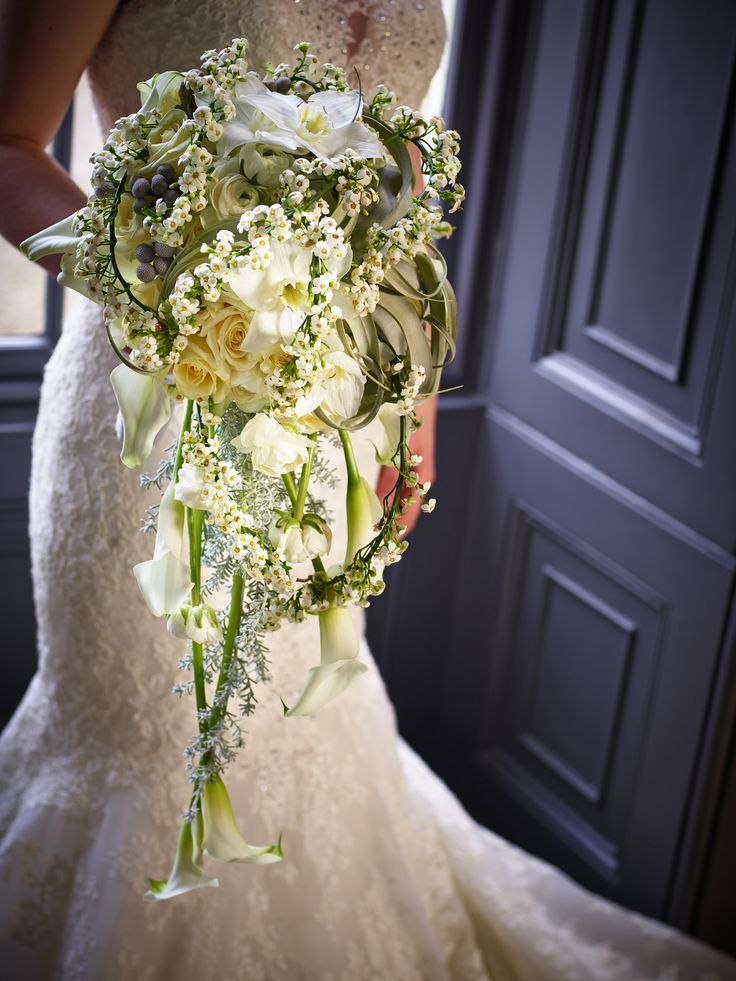 Succulent greens and heavenly whites fill this bridal bouquet with perfection.